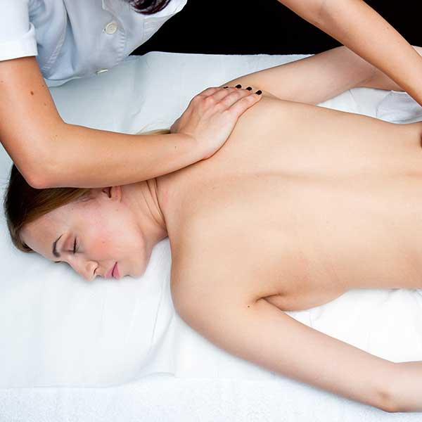 woman receiving chiropractic back adjustment
