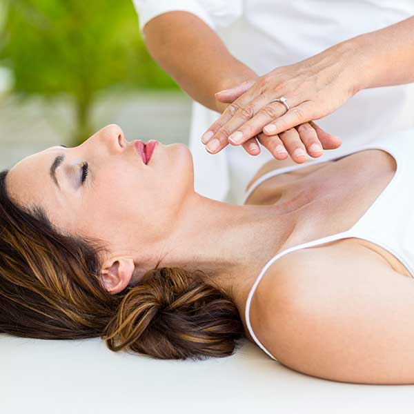 woman getting reiki treatment
